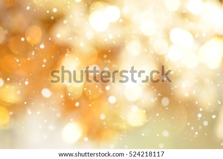 Abstract gold bokeh with snow, Christmas and new year theme background Royalty-Free Stock Photo #524218117