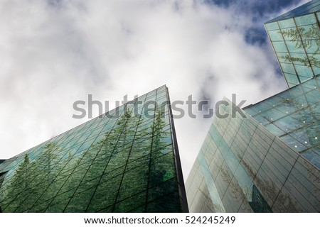 Sustainable, green energy city, urban ecology concept and modern business buildings surface covered in forest with copy space. 