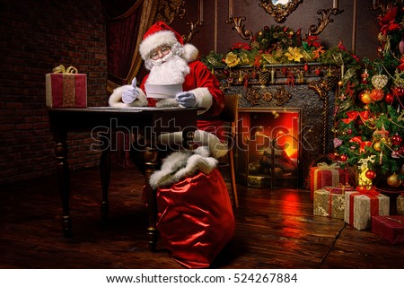 Santa Claus is preparing for Christmas, he is reading children's letters. Mail of Santa Claus. Christmas decoration.  #524267884