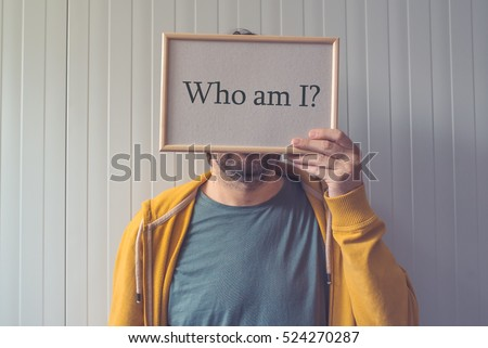 Introspective man  - Who am I, self-knowledge concept with question covering adult male face. #524270287