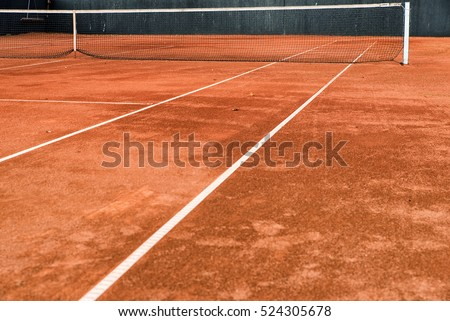 Empty Clay Tennis Court and Net. #524305678