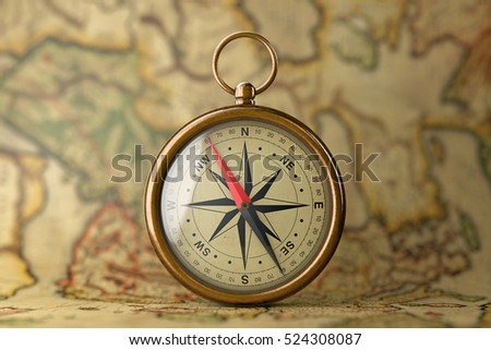 Antique Vintage Brass Compass on a Rare Map extreme closeup. 3d Rendering  #524308087
