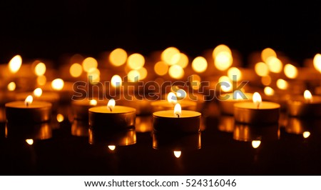 Many burning candles with shallow depth of field Royalty-Free Stock Photo #524316046