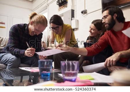Designers Sitting On Sofa Having Creative Meeting In Office #524360374