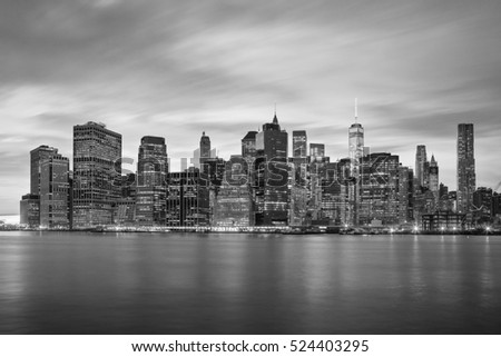 New York City - Famous Manhattan skylines, black and white, moody clouds, NYC, USA #524403295