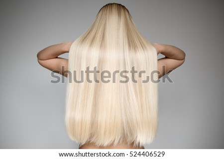 Portrait Of A Beautiful Young Blond Woman With Long Straight Hair. Back View #524406529