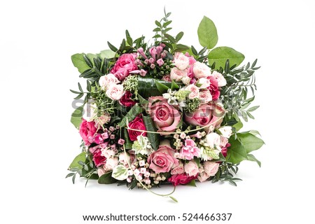 Rich bunch of pink flowers and lilac eustoma roses, green leaf. Fresh spring bouquet on a white background #524466337