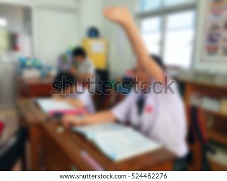Blur kids and teacher in the classroom for background usage. #524482276