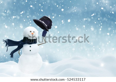 New year greeting card with copy-space.Happy snowman standing in christmas landscape.Snow background Royalty-Free Stock Photo #524533117