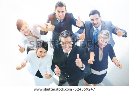 Top view of executives smiling and pointing #524559247