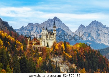 Beautiful view of the Neuschwanstein castle in autumn. Palace situated in Bavaria, Germany. Neuschwanstein is one of the most popular of all palaces and castles in Europe and world. #524572459
