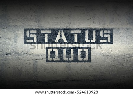 status quo stencil print on the grunge white brick wall #524613928