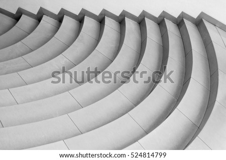 Curvilinear stairs. Top view of modern architecture detail. Refined fragment of contemporary office interior / public building. Royalty-Free Stock Photo #524814799