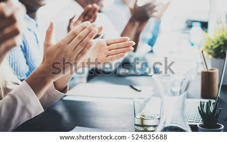 Closeup photo of partners clapping hands after business seminar. Professional education, work meeting, presentation or coaching concept.Horizontal,blurred background Royalty-Free Stock Photo #524835688