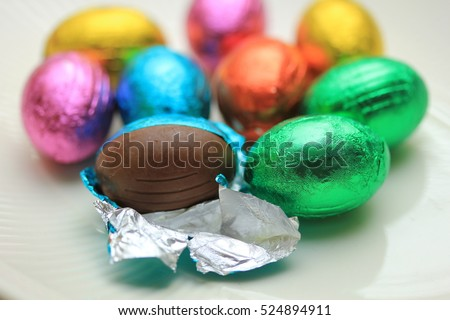 a group of foil wrapped chocolate easter eggs Royalty-Free Stock Photo #524894911