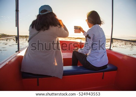 Tourist taking Pictures Using Mobile Phone, Mobile Photography.