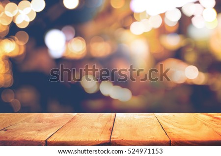 Empty of wood  table top with  blurred light gold bokeh abstract background.For montage product display or design key visual layout #524971153