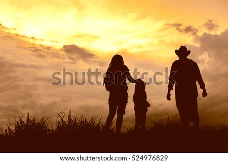 Silhouette happy family.Father and little daughter silhouettes play at sunset #524976829