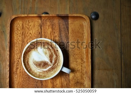 Morning Coffee; hot fresh coffee in cup with morning light #525050059