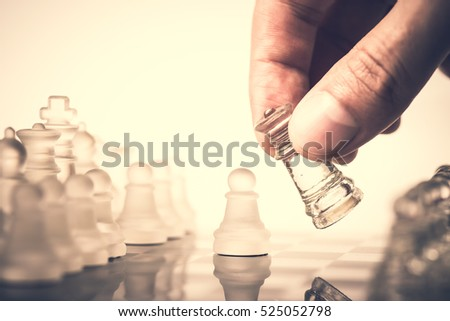Chess. Strategy game. Competition success play. Intelligence challenge concept. King move on chessboard. White and black pawn on board. Business leadership. Leisure sport. Royalty-Free Stock Photo #525052798