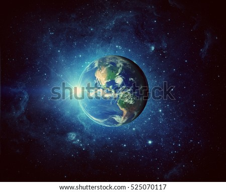 Earth and galaxy. Elements of this image furnished by NASA. Royalty-Free Stock Photo #525070117