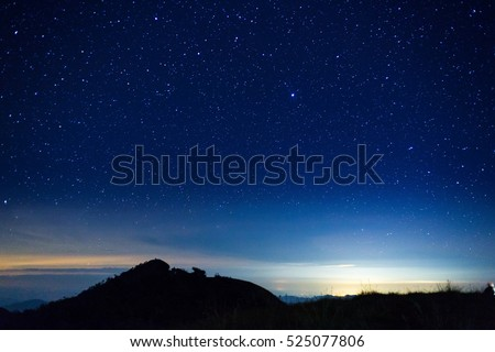 night sky with star on top of mountain Royalty-Free Stock Photo #525077806