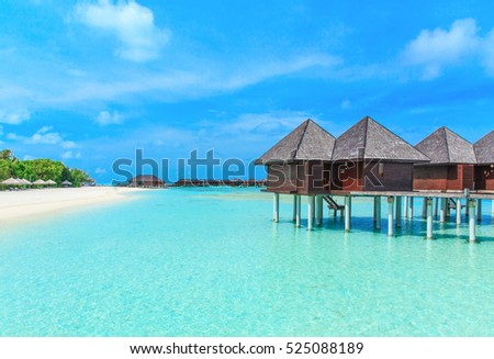beach with water bungalows at Maldives #525088189
