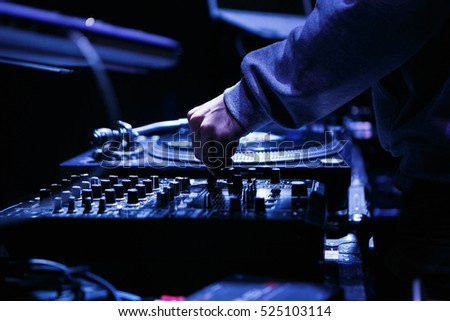 MOSCOW - 15 NOVEMBER,2016: Dj play music at hip hop party in club.Turntable vinyl record player,analog sound technology for disc jockey to scratch vinyl records,mix tracks #525103114