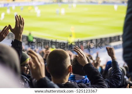 Hand fans who clap their hands at the stadium Royalty-Free Stock Photo #525123367