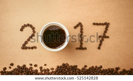 2017 coffee beans on paper texture in vintage style for new year concept
