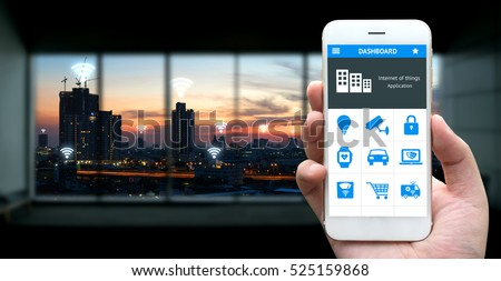 Internet of things , iot , smart home , smart city and network connect concept. Human hand holding white phone and application with city sunset view background and wifi icons #525159868