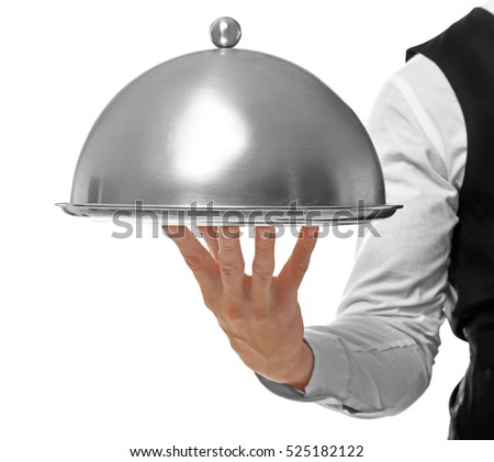 Waiter holding metal tray with cover on white background, close up view #525182122