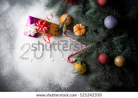Christmas decorations with fir-tree branches, Christmas tree decorations and tangerines  #525242350
