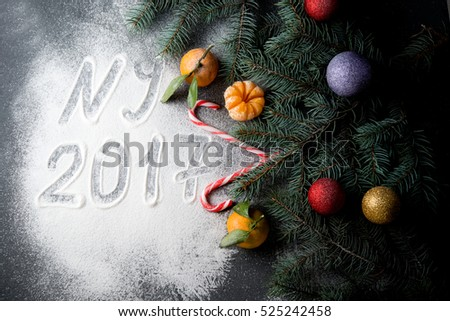 Christmas decorations with fir-tree branches, Christmas tree decorations and tangerines  #525242458