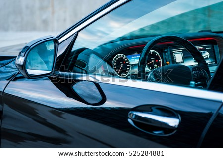 Luxury car interior details. Dashboard and steering wheel #525284881