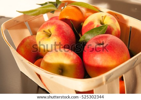 Basket of fruit with apples and clementines #525302344