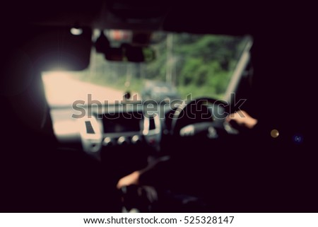 blurred image of people driving car on day time #525328147