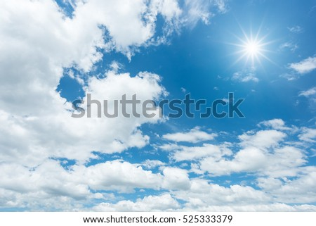 Blue sky with clouds and sun reflection #525333379