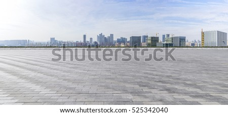 Panoramic skyline and buildings with empty concrete square floor #525342040