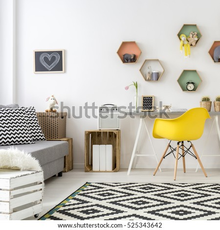 Spacious white cozy teenager room designed in scandinavian style. On the floor carpet in white and black pattern #525343642
