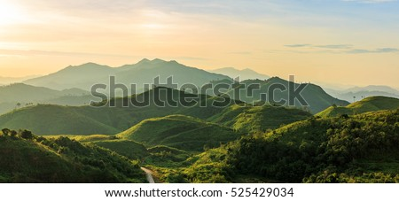 Beautiful sunrise over the mountain range at the west of thailand #525429034