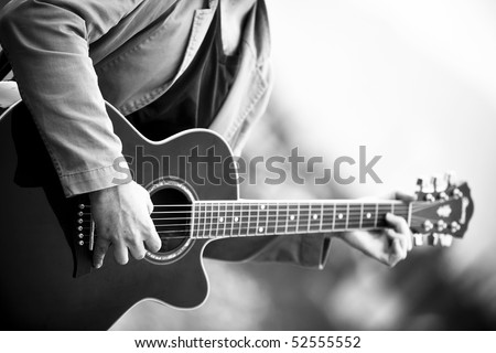 Anonymous guitar performer in beautiful black and white tone. #52555552