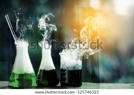 Double exposure of science laboratory test tubes with bokeh and chemical reaction #525746323