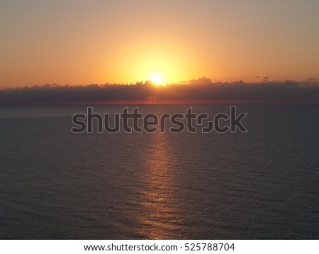 Beautiful Sunrise over a Ocean with reflections on the water