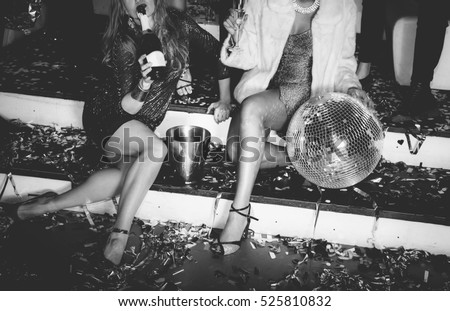 Friends having fun in the disco Royalty-Free Stock Photo #525810832