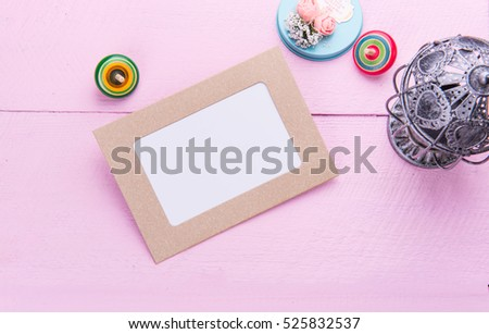 Paper photo frame in pink background.