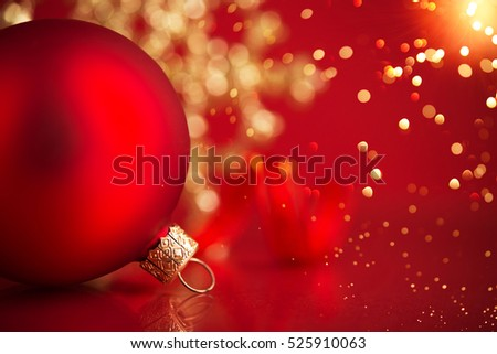 Golden and red christmas ornaments on red holiday background with twinkle bokeh light. Merry christmas card. Winter xmas theme. #525910063