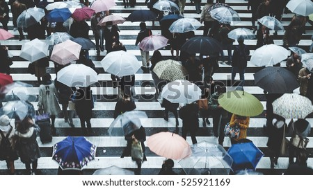 People across the crosswalk on a rainy day #525921169