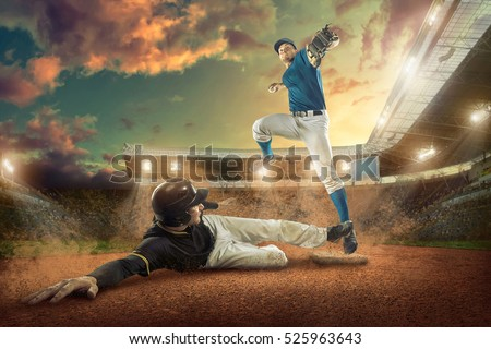 Baseball players in action on the stadium. #525963643
