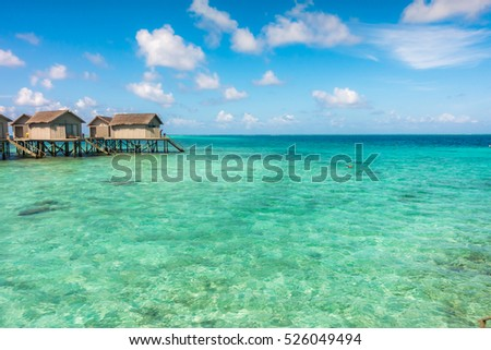 Beautiful tropical Maldives resort hotel with beach and blue water #526049494